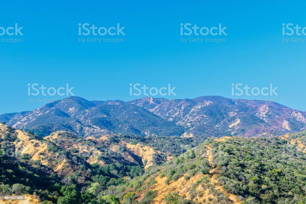Red fire retardant hills stock photo