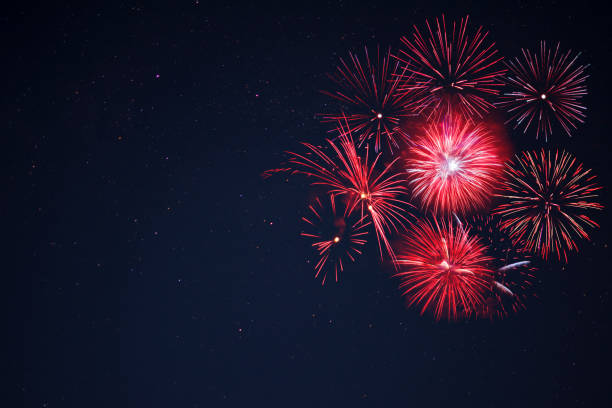 red  fireworks located right side over night sky - fireworks stock pictures, royalty-free photos & images