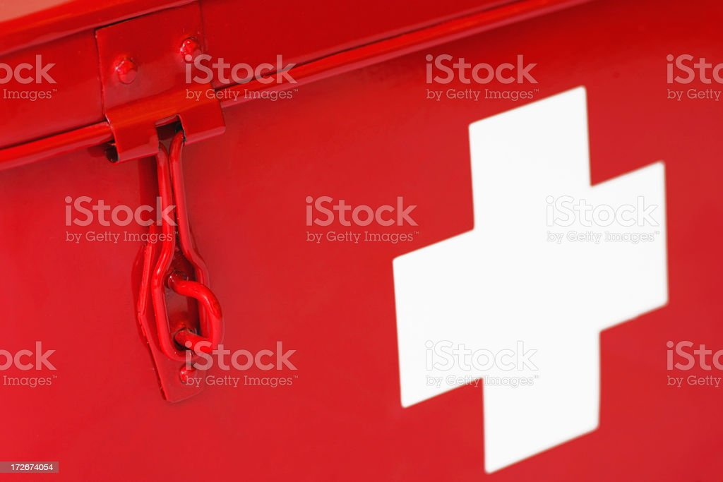 Red first aid box with big thick white cross on side stock photo