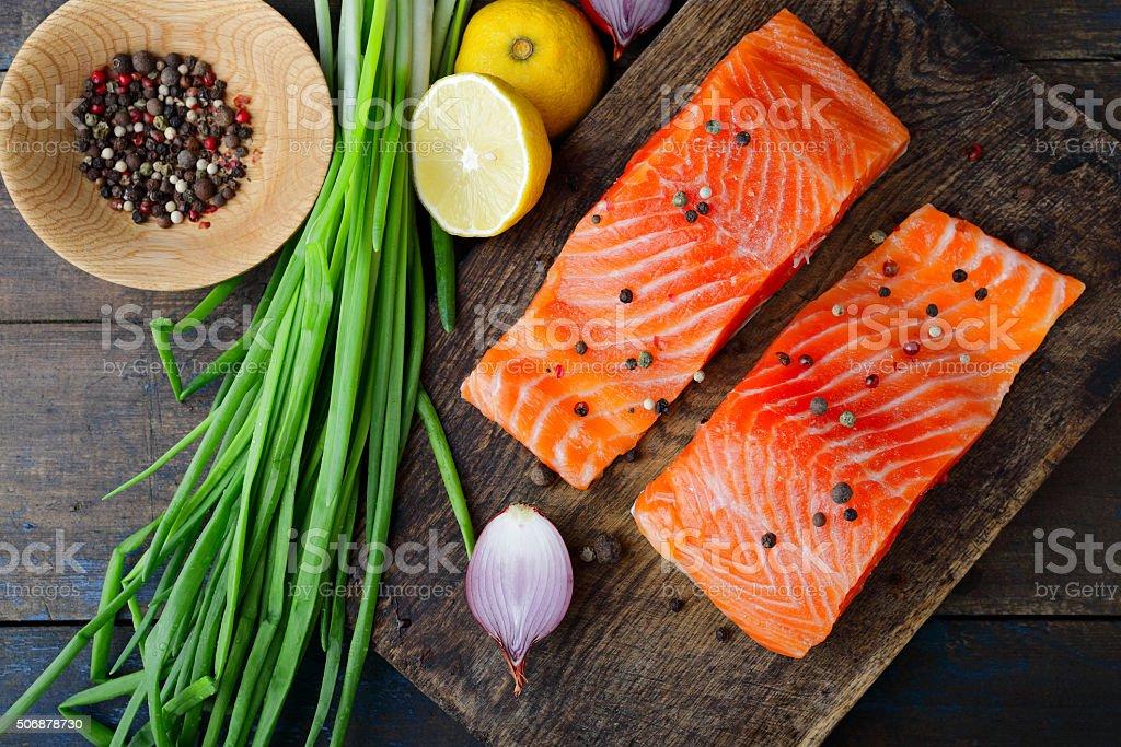 Red fish on cutting board stock photo