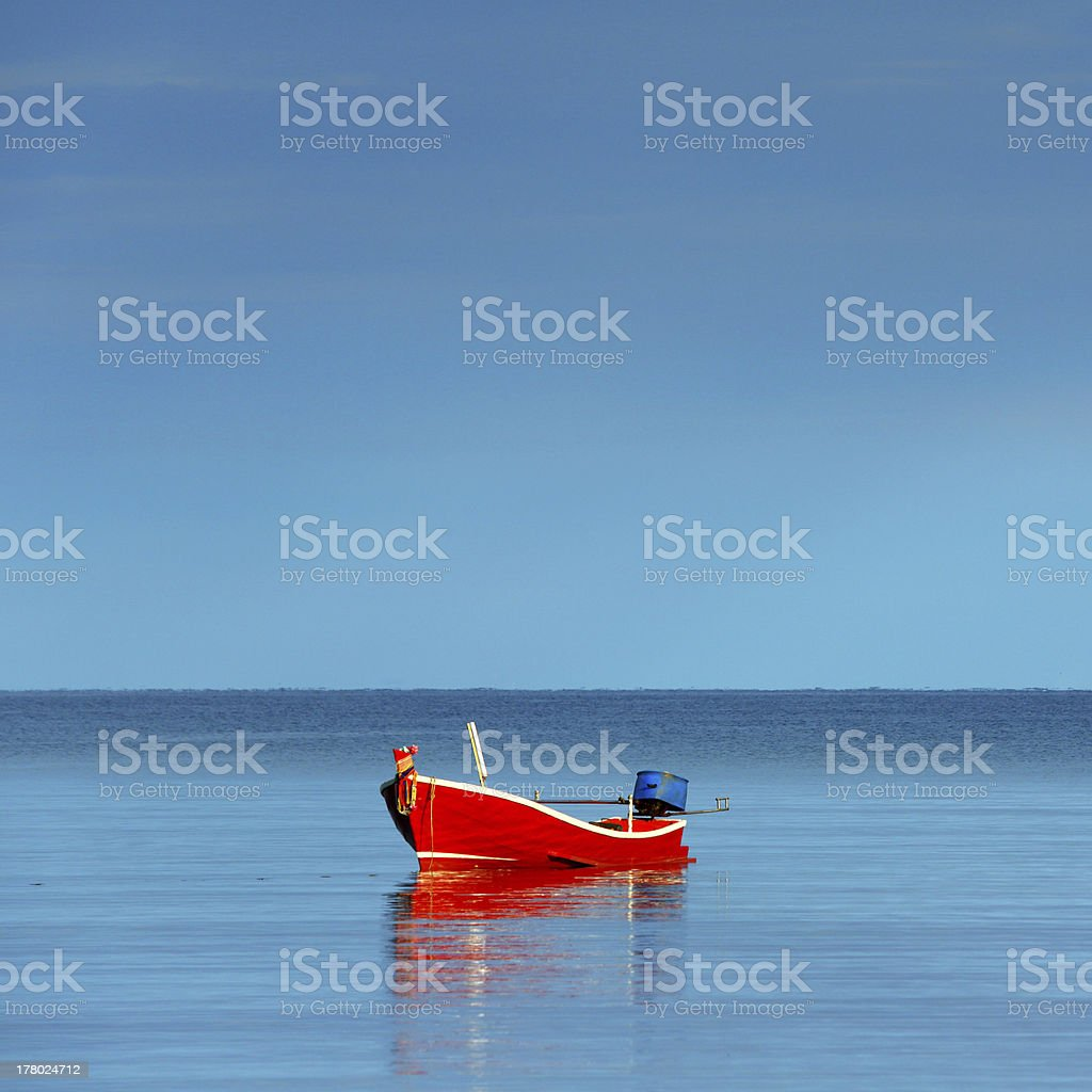 Red Fishing Boat Alone on Calm Morning Sea royalty-free stock photo