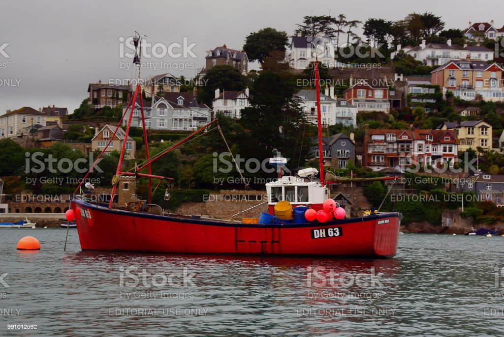 Red fishing boat at Anchor on River Dart stock photo