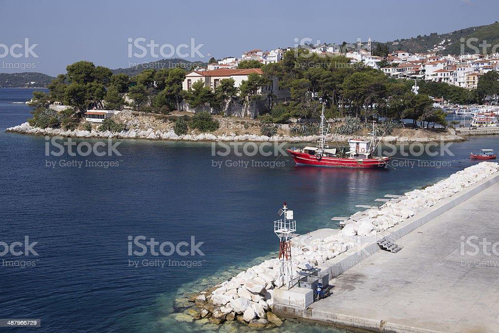 Red fishing boat in Skiatos port stock photo