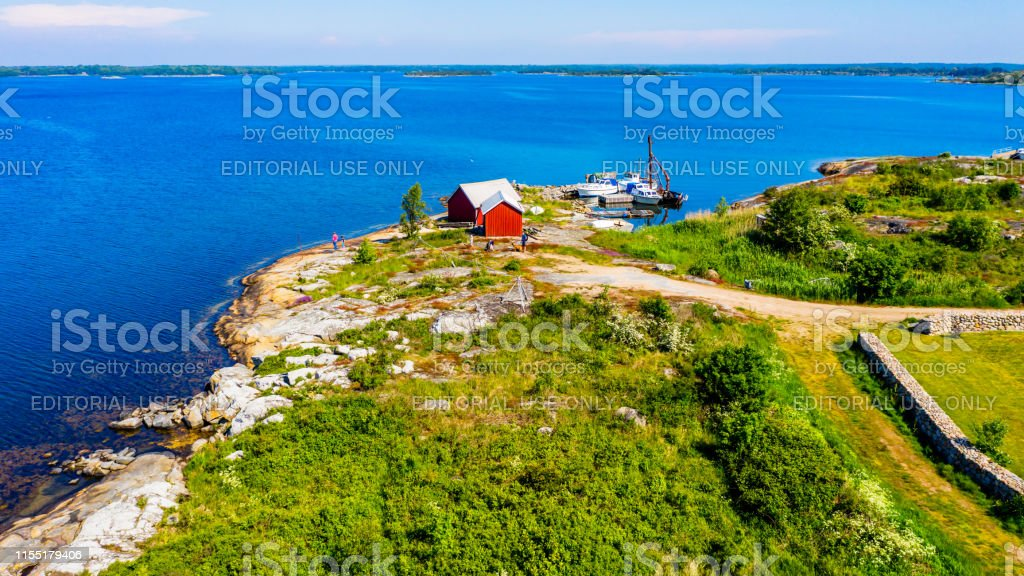 Red Fishing Sheds In Coastal Landscape Stock Photo