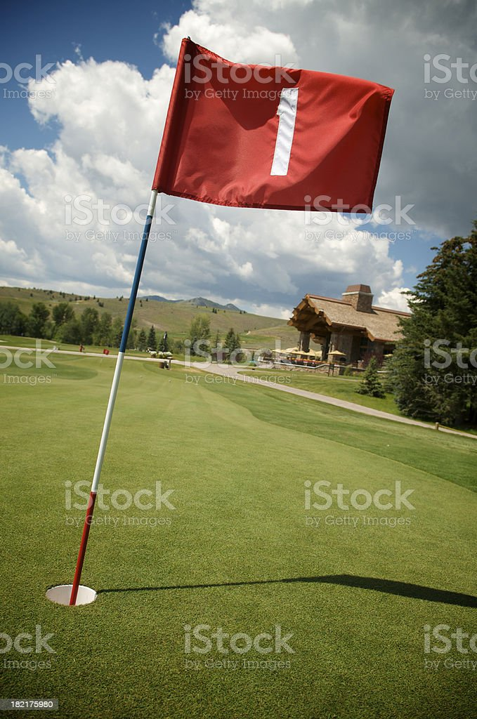 Red Flag First Hole on Green Golf Course stock photo