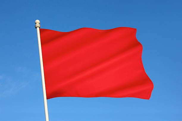 Red Flag of Danger stock photo