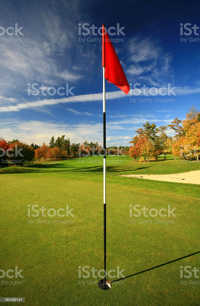 Red Flag on a Beautiful Golf Course in Fall stock photo