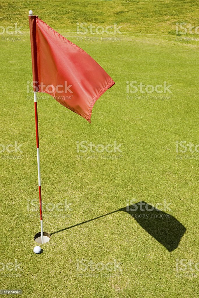 Red flag on a golf course royalty-free stock photo