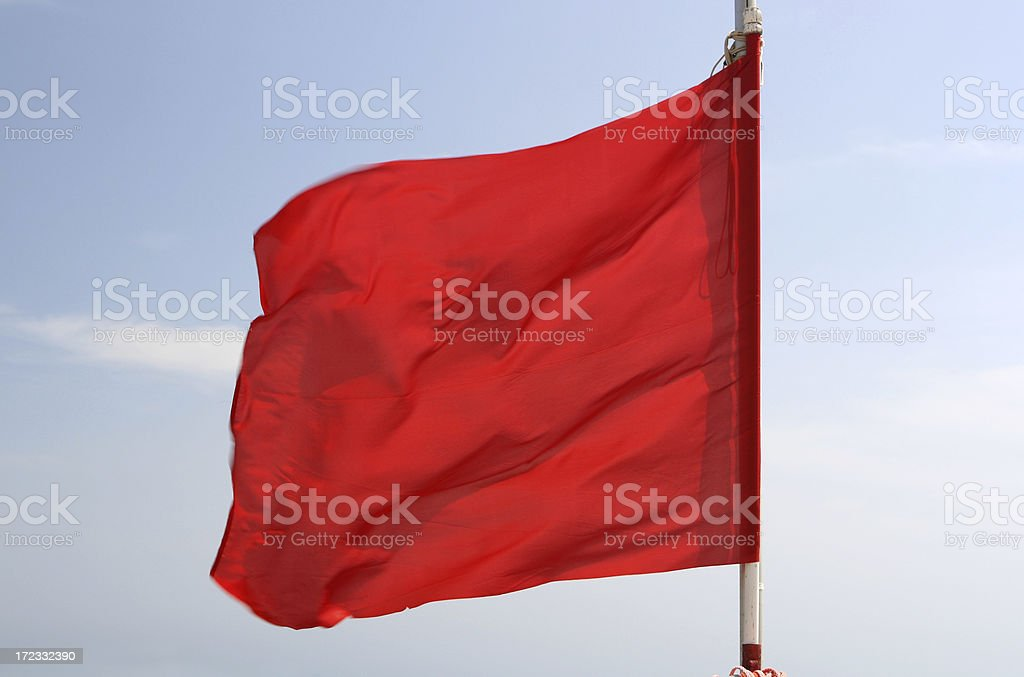 Red flag on the beach in Italy royalty-free stock photo