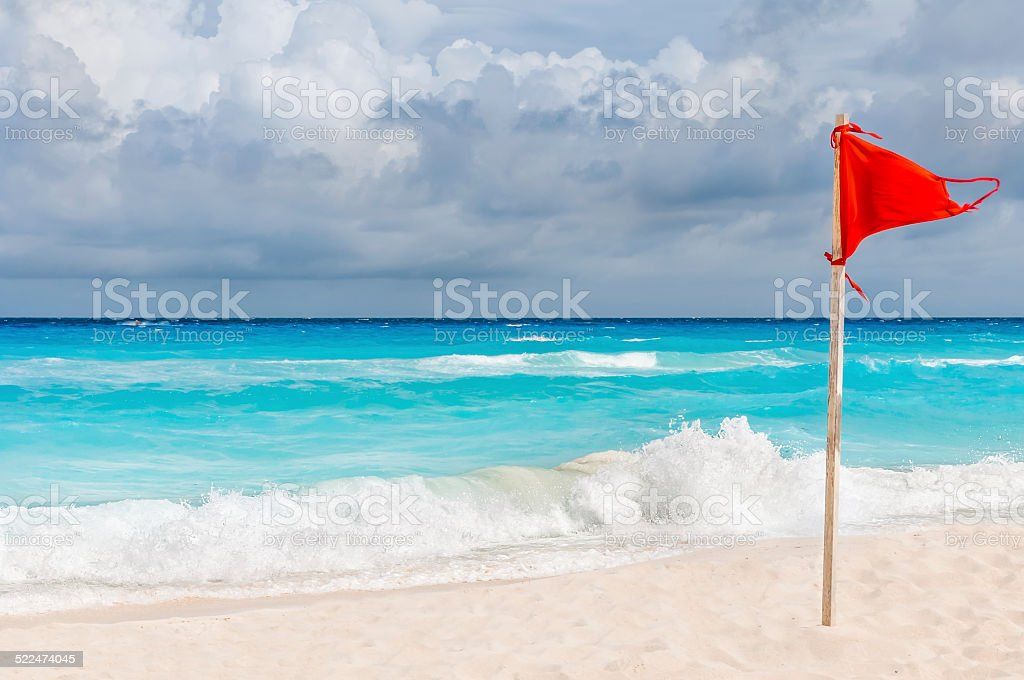 Red flag on the beach. stock photo