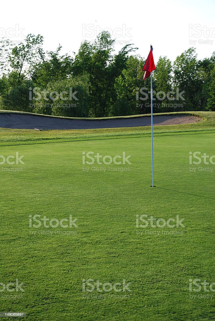 Red flag on the golf course royalty-free stock photo