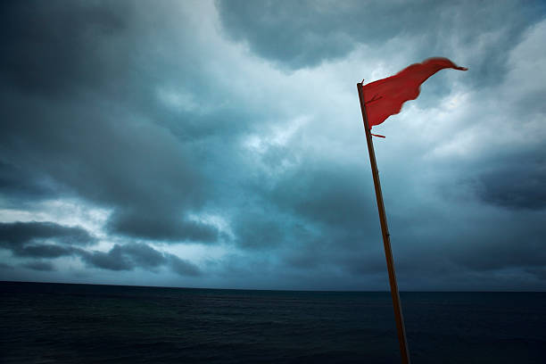 Red Flag Warning Hurricane Storm Danger of Dark Sea Clouds stock photo