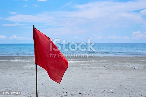 istock Red flag with the sea, Signal warning. 1127082841