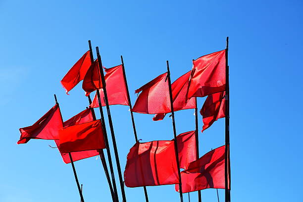 Red flags on blue sky Red flags of a fishermans boat on blue sky background! pejft stock pictures, royalty-free photos & images