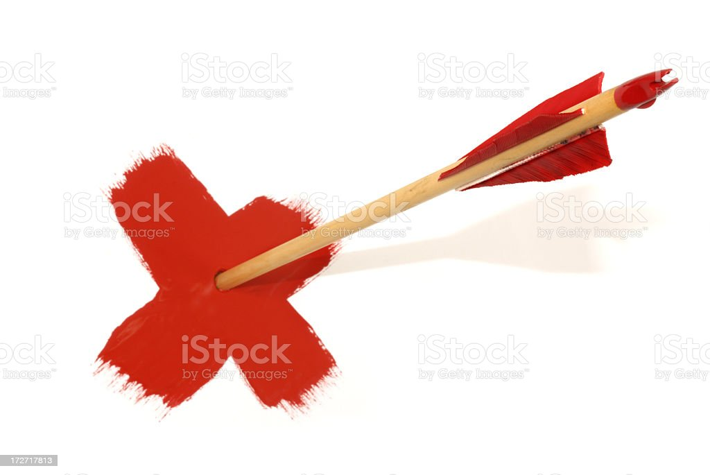 Red fletched arrow piercing painted red x on white board royalty-free stock photo