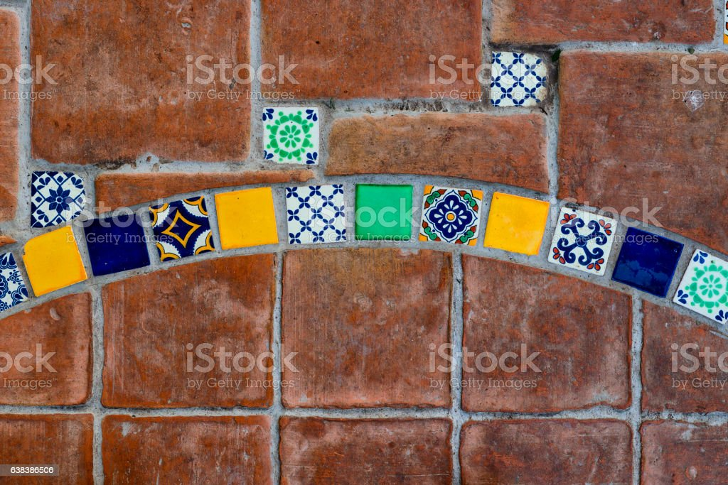 Red Floor Tiles With Mediterranean Style Coloured Tiles Stock Photo