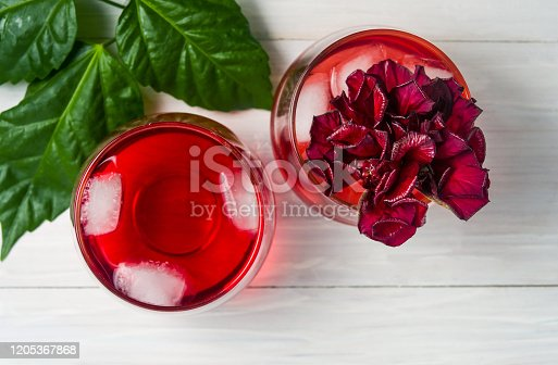 Red flower and hibiscus cocktail isolated on white