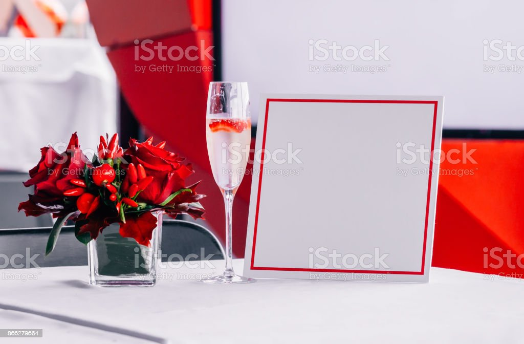 Red flowers and champagne stock photo