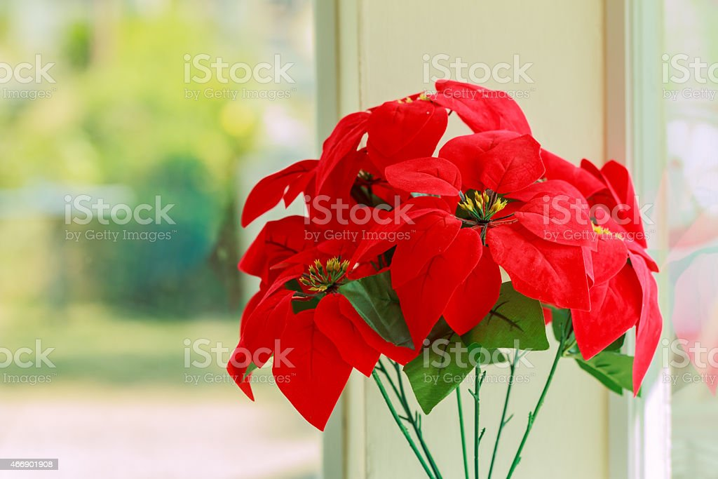 Red flowers made from fabric stock photo