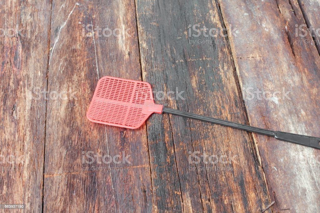 Red fly swatter. Single flyswatter made of plastic stock photo