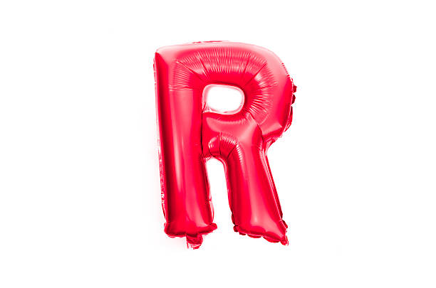 Red foil balloon alphabet letter R isolated on white stock photo