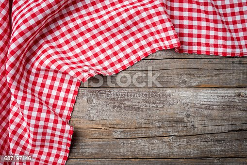 istock Red folded tablecloth on an old wooden table 687197146