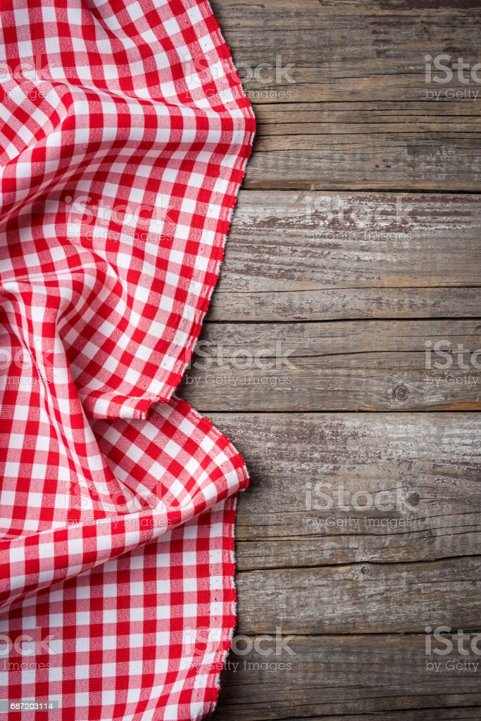Red folded tablecloth on an old wooden table stock photo