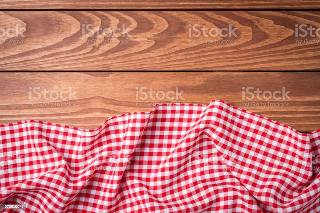 Red folded tablecloth on wooden table stock photo