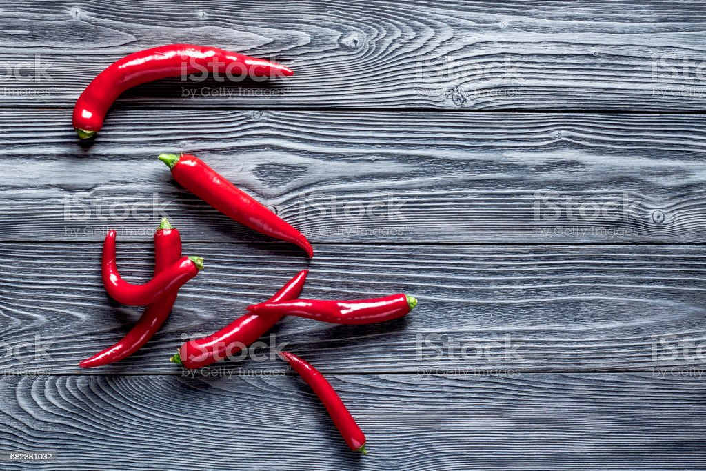 red food with chili pepper on dark background top view space for text royalty-free stock photo