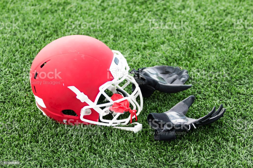 Red football helmet and gloves stock photo
