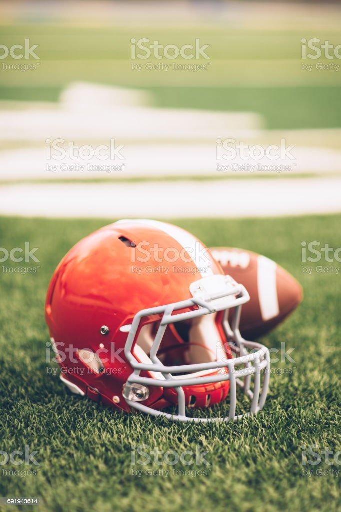 Red Football Helmet on Field stock photo