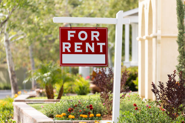 Red For Rent Real Estate Sign in Front House stock photo