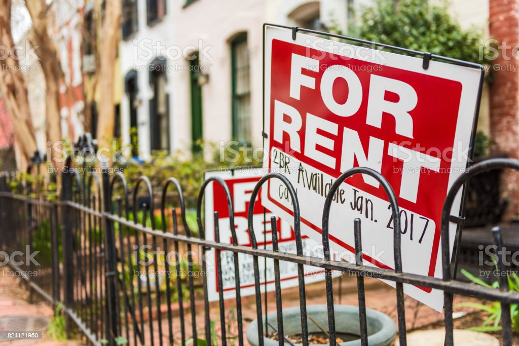 Red For Rent sign with details on front porch of house royalty-free stock photo