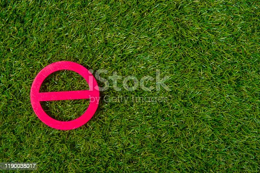 istock Red forbidden sign on isolated green grass background. 1190038017