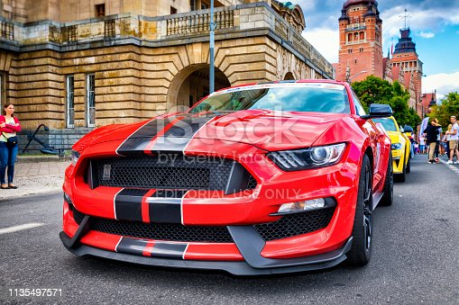 Szczecin, Poland - June 30, 2018: A Ford GT Shelby parked on a street in the Szczecin city center. At this public Mustang car lovers' gathering people walk in the background admiring the many Mustang cars.