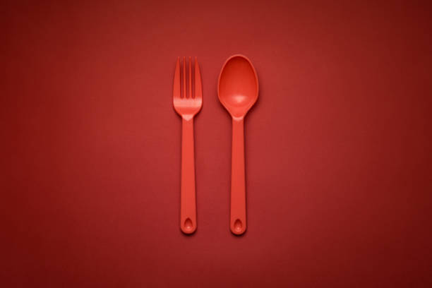 Red Fork & Spoon on red background - foto stock