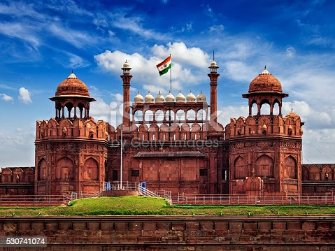 India famous travel tourist landmark and symbol - Red Fort (Lal Qila) Delhi with Indian flag - World Heritage Site. Delhi, India