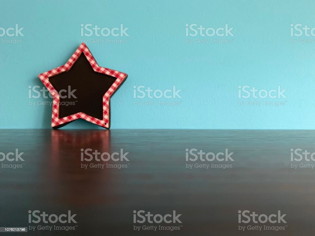 Red framed star shape on blue background