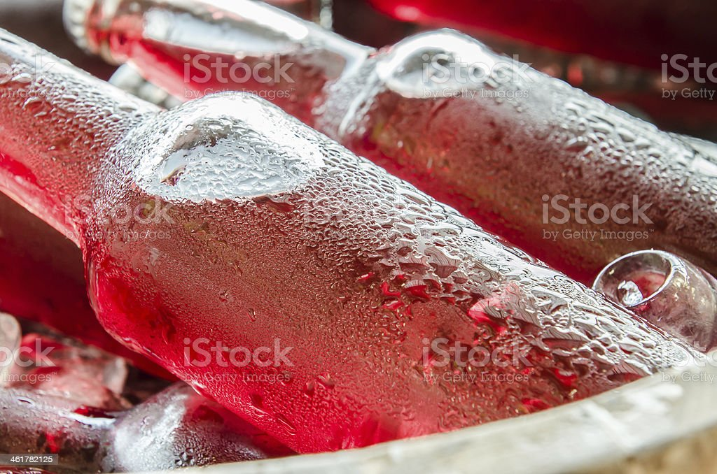 red fresh drinks with ices closeup stock photo