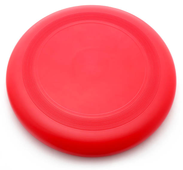 Red Frisbee Red Frisbee isolated over white background plastic disc stock pictures, royalty-free photos & images