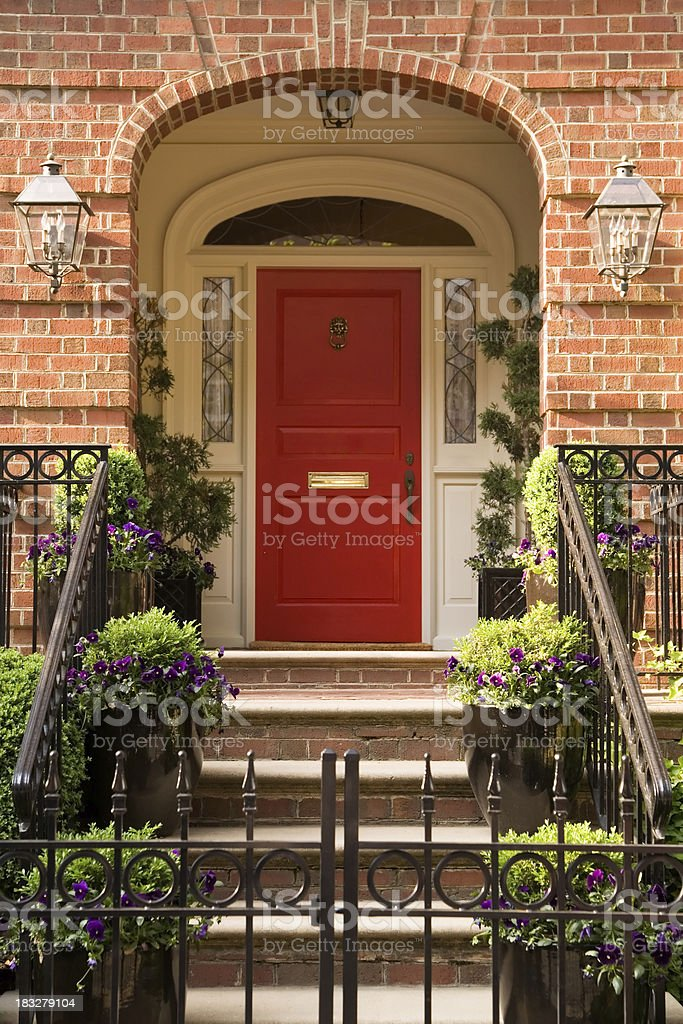 Red Front Door on a Brick Town House royalty-free stock photo