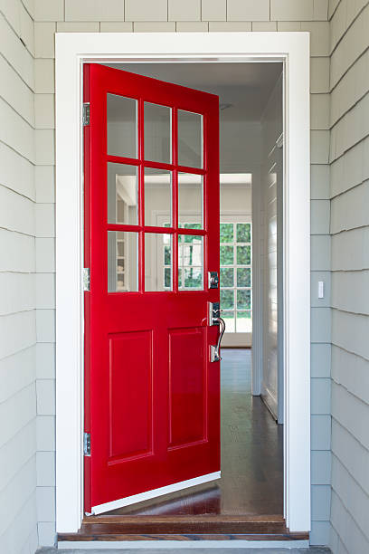 Red Front Door Front entrance to a residential home with a red solid wood door. The surrounding walls are covered with shingles. front door stock pictures, royalty-free photos & images