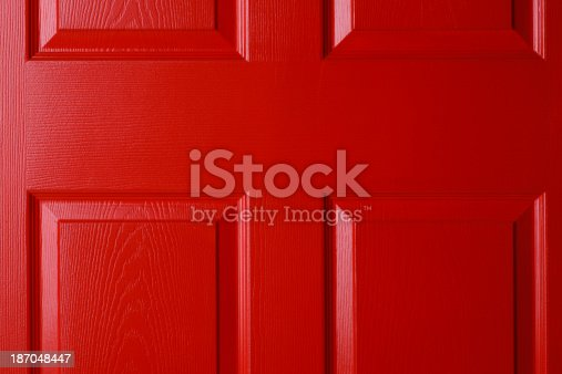 Close up of a red front door.