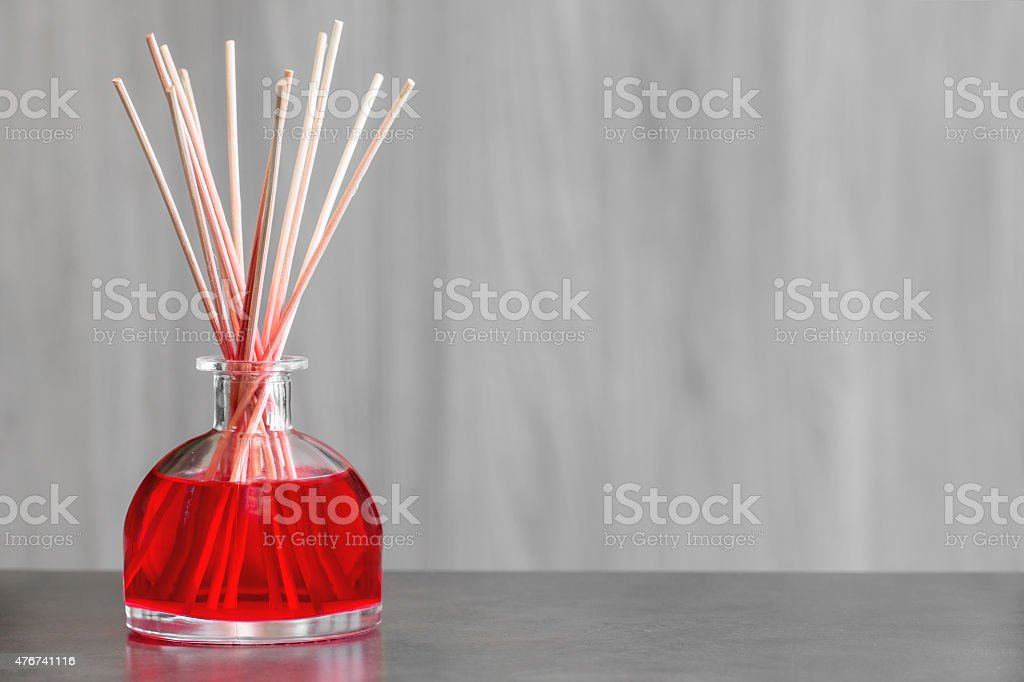 Red fruit air freshener perfume diffuser background stock photo