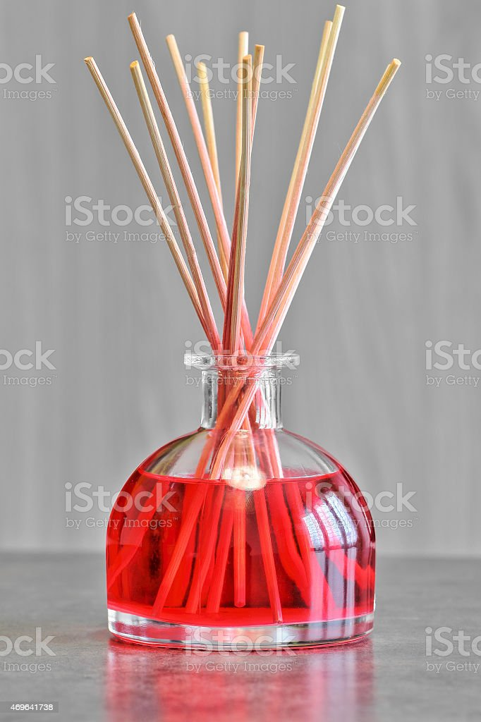 Red fruit air freshener perfume diffuser vertical stock photo