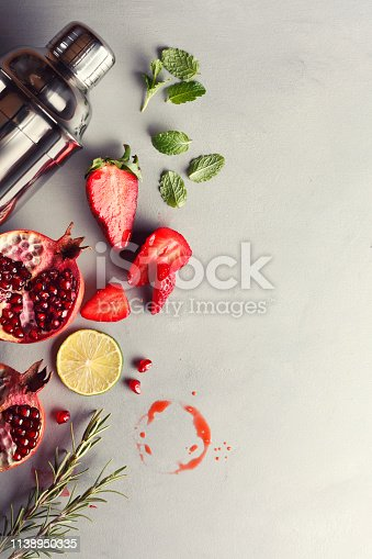 Strawberry and pomegranate cocktail with rosemary.