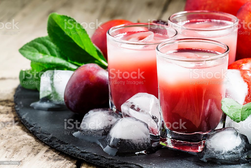 Red fruit cocktail with ice stock photo