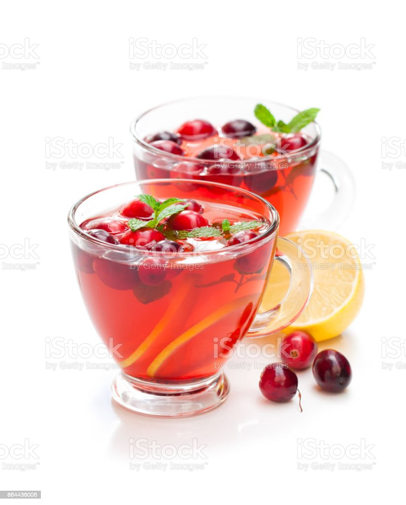 Red  fruit tea with lemon and cranberry isolated on white background stock photo