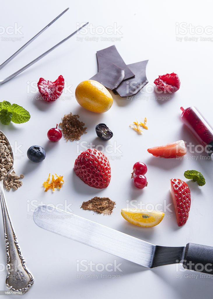 Red fruits and spices with tools stock photo