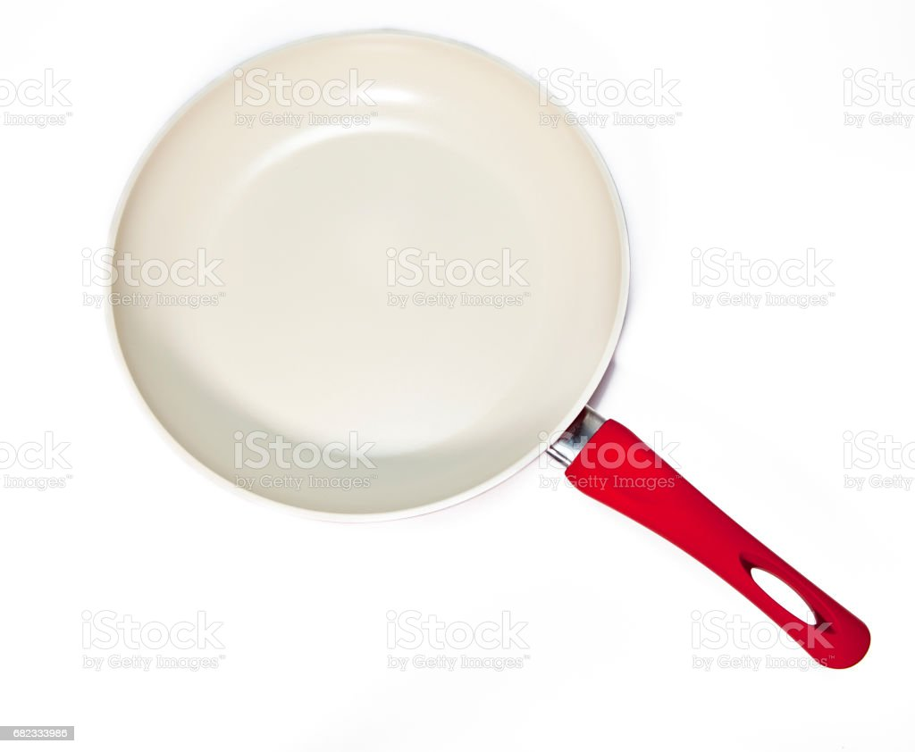 red frying pan stock photo